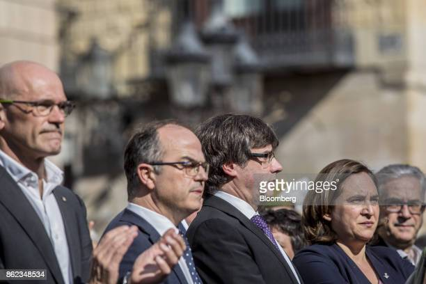 Carles Puigdemont Catalonia's president center Ada Colau mayor of Barcelona center right Jordi Turell Catalan government spokesman center left and...