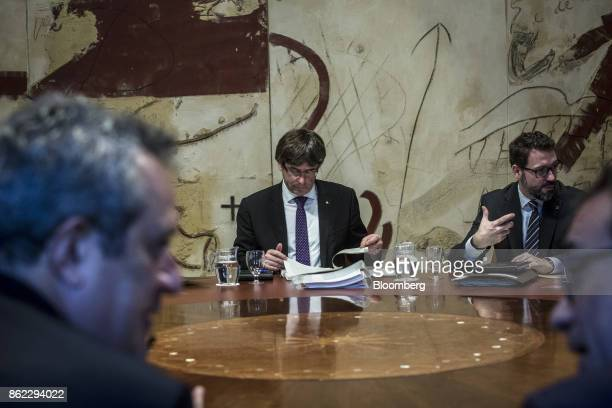 Carles Puigdemont Catalonia's president center and Oriol Junqueras leader of Esquerra Republicana de Catalunya left attend a session of the...