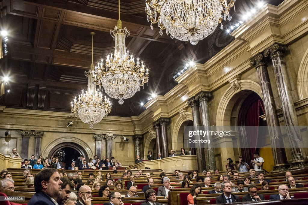 Carles Puigdemont, Catalonia's president, center, and Oriol Junqueras, leader of Esquerra Republicana de Catalunya, left, listen during a debate at the Catalan parliament in Barcelona, Spain, on Thursday, Oct. 26, 2017. Catalonia's president says he won't call a regional election that could have defused tension with Spain. Photographer: Angel Garcia/Bloomberg via Getty Images