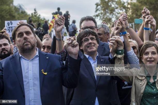 Carles Puigdemont Catalonia's president center applauds during a demonstration against the Spanish government and the imprisonment of separatist...