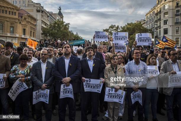Carles Puigdemont Catalonia's president center holds a sign that reads 'Free The Jordis' during a demonstration against the Spanish government and...