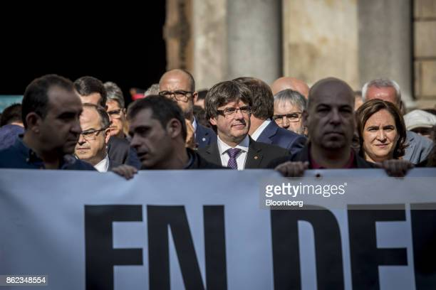 Carles Puigdemont Catalonia's president center joins other government officials in a silent demonstration outside the Generalitat in support of...