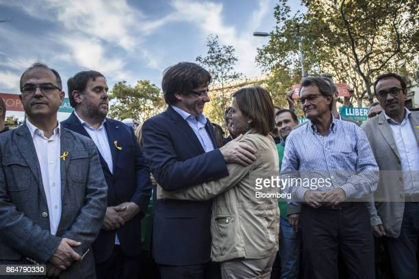 Carles Puigdemont Catalonia's president center left embraces Carme Forcadell Catalonia's parliament president during a demonstration against the...