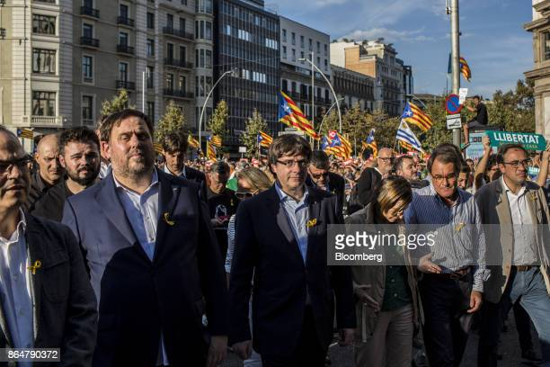 Carles Puigdemont Catalonia's president center participates in a demonstration against the Spanish government and the imprisonment of separatist...