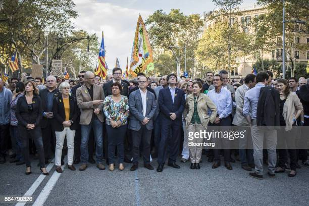 Carles Puigdemont Catalonia's president center right participates in a demonstration against the Spanish government and the imprisonment of...