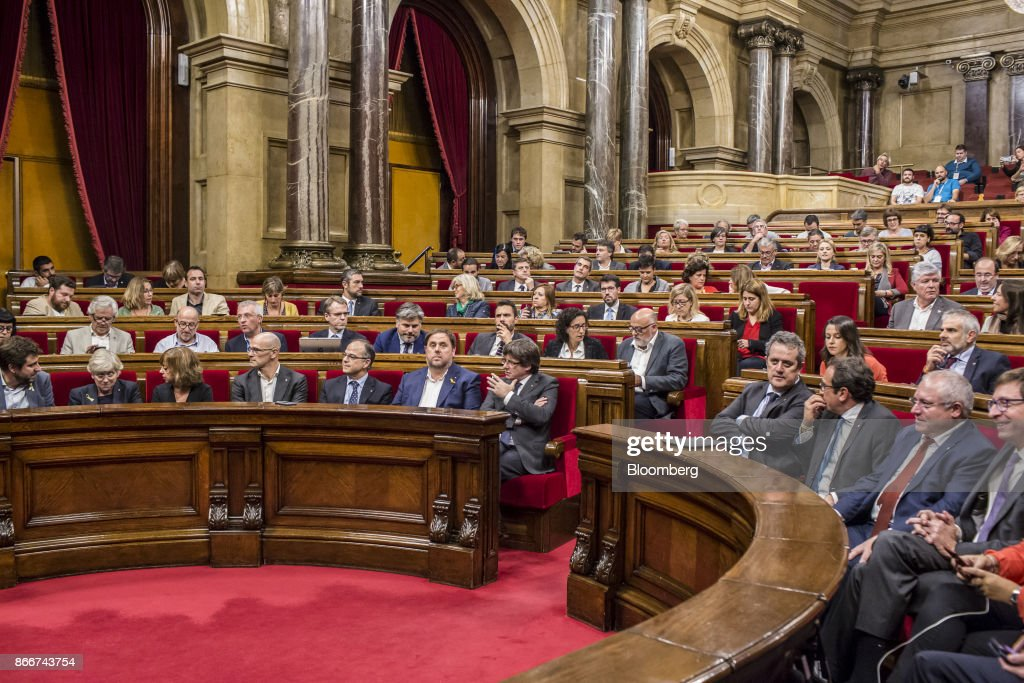 Carles Puigdemont, Catalonia's president, front center left, sits during a parliament session in Barcelona, Spain, on Thursday, Oct. 26, 2017. Puigdemont says he won't call a regional election that could have defused tension with Spain. Photographer: Angel Garcia/Bloomberg via Getty Images