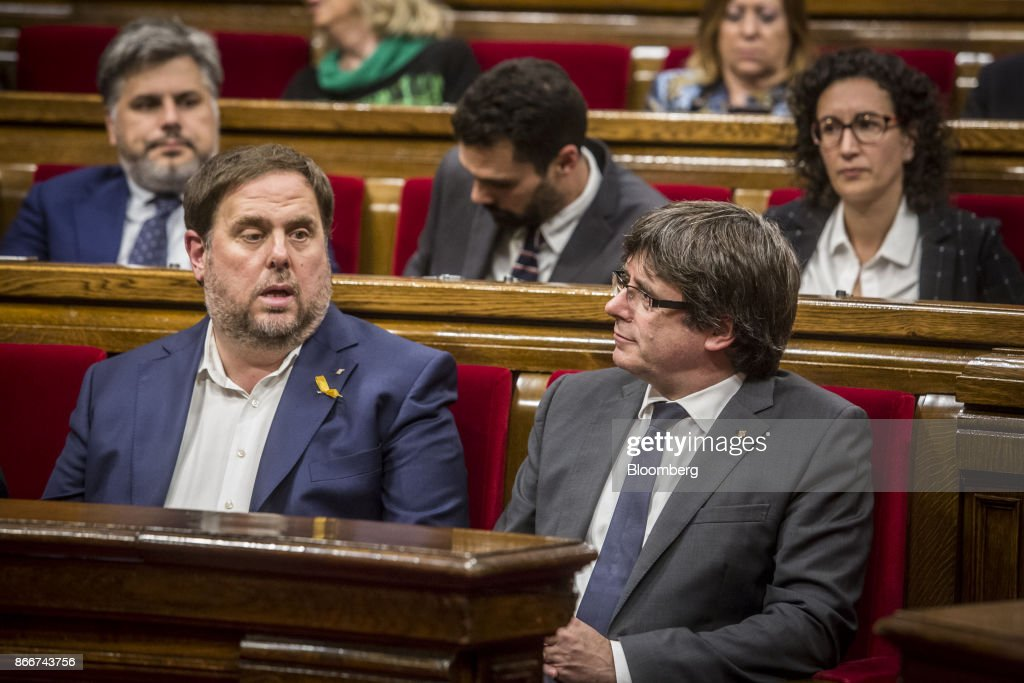 Carles Puigdemont, Catalonia's president, front right, sits during a parliament session in Barcelona, Spain, on Thursday, Oct. 26, 2017. Puigdemont says he won't call a regional election that could have defused tension with Spain. Photographer: Angel Garcia/Bloomberg via Getty Images