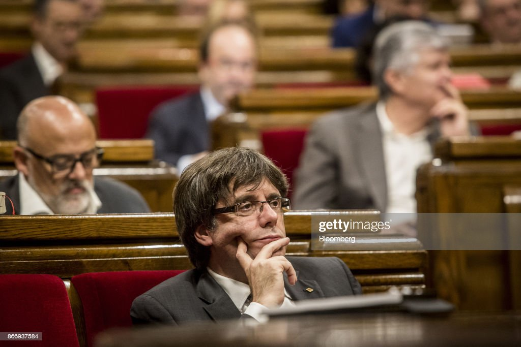 Carles Puigdemont, Catalonia's president, looks on during a debate at the Catalan parliament in Barcelona, Spain, on Thursday, Oct. 26, 2017. Catalonia's president says he won't call a regional election that could have defused tension with Spain. Photographer: Angel Garcia/Bloomberg via Getty Images