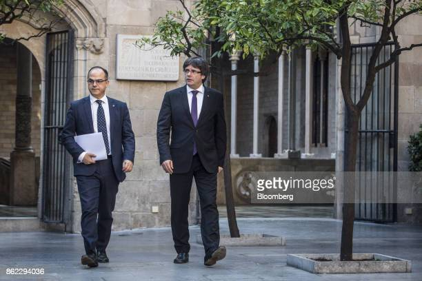 Carles Puigdemont Catalonia's president right and Jordi Turull Catalan government spokesman exit following a session of the Generalitat regional...