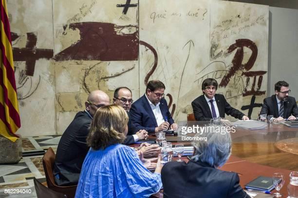 Carles Puigdemont Catalonia's president second right Oriol Junqueras leader of Esquerra Republicana de Catalunya center Jordi Turull Catalonia...