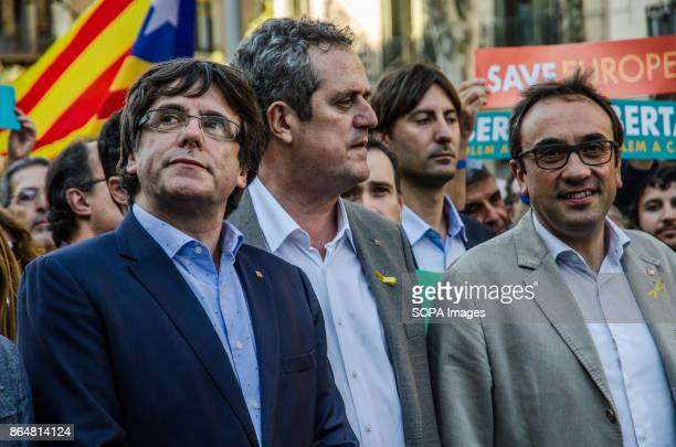 Carles Puigdemont Joaquim Forn and Josep Rull seen at the rally About 450000 people have been focused to support the Government and the Catalan...