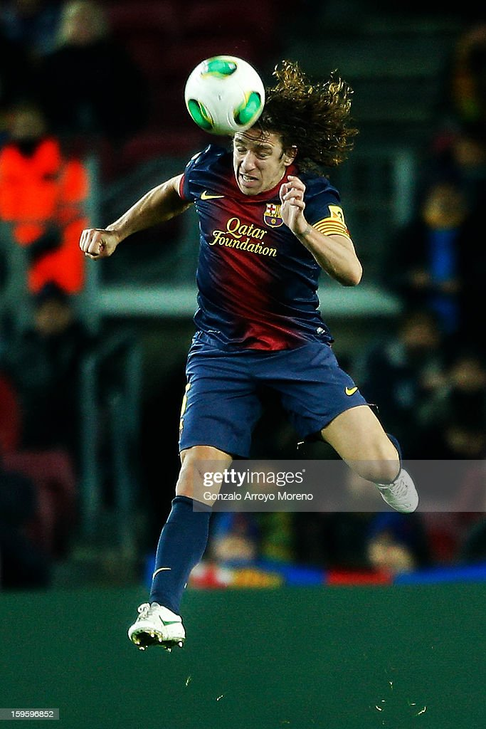 Carles Pujol of Barcelona FC heads the ball during the Copa del Rey Quarter Final match between Barcelona FC and Malaga CF at Camp Nou on January 16, 2013 in Barcelona, Spain.