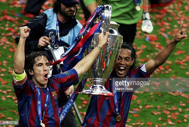 Carles Puyol and Ronaldinho of Barcelona carry the trophy in celebration after they win the UEFA Champions League Final between Arsenal and Barcelona...