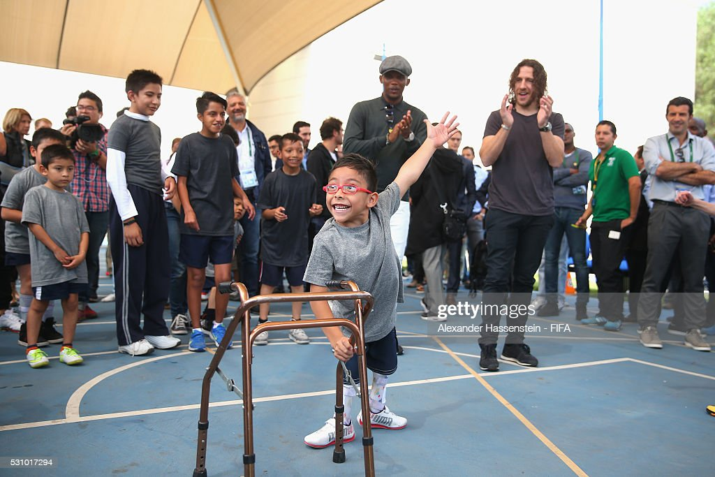 Carles Puyol (R) and Samuel Etoo plays football with the kids as they and the FIFA Legends visit the Teleton foundation rehabilitation center at CRIT Estado de M��xico ahead of the 66th FIFA Congress on May 12, 2016 in Mexico City.