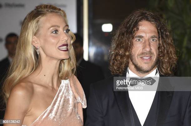 Carles Puyol and Vanesa Lorenzo attend Lionel Messi and Antonela Rocccuzzo's wedding at the City Center Rosario Hotel Casino on June 30 2017 in...