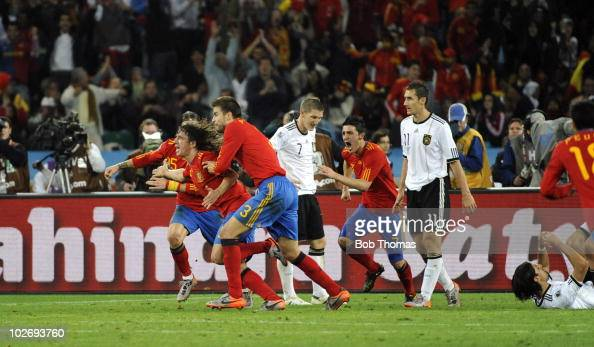 Carles Puyol celebrates with teammates including Gerard Pique after scoring Spain's goal during the 2010 FIFA World Cup South Africa Semi Final match...