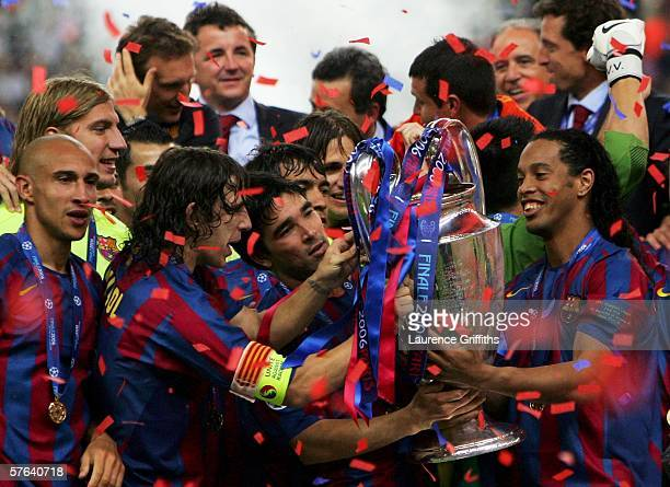 Carles Puyol Deco and Ronaldinho of Barcelona lift the trophy with celebrating team mates after they win the UEFA Champions League Final between...