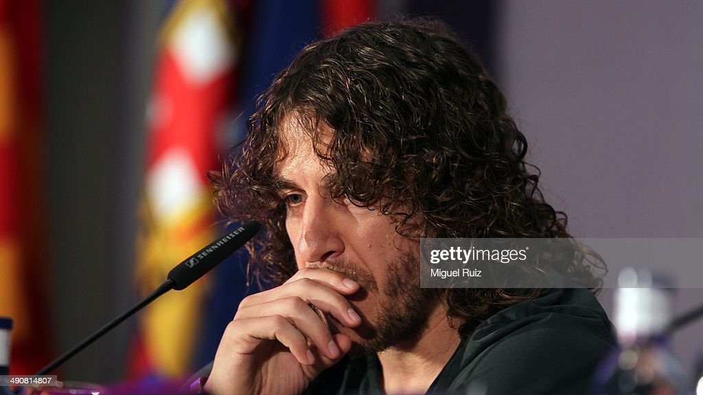 <a gi-track='captionPersonalityLinkClicked' href=/galleries/search?phrase=Carles+Puyol&family=editorial&specificpeople=211383 ng-click='$event.stopPropagation()'>Carles Puyol</a> looks eotional as he gives a press conference to bid farewell to Barcelona FC at the Auditorium 1899 on May 15, 2014 in Barcelona, Spain.