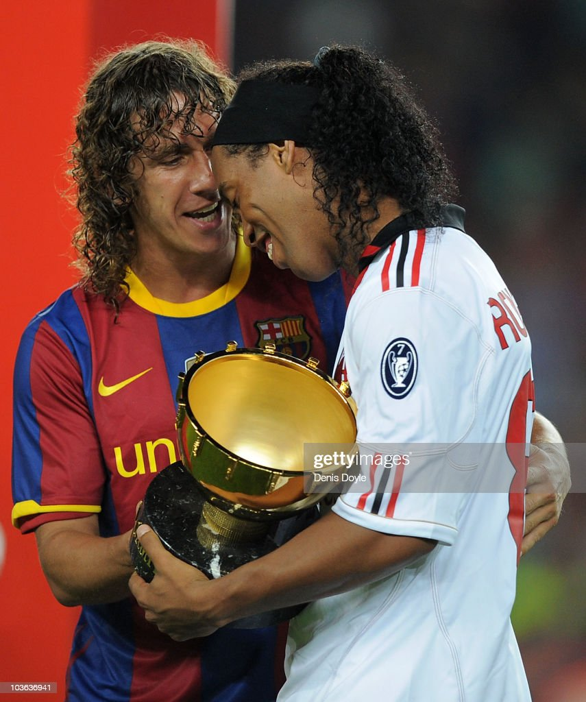 <a gi-track='captionPersonalityLinkClicked' href=/galleries/search?phrase=Carles+Puyol&family=editorial&specificpeople=211383 ng-click='$event.stopPropagation()'>Carles Puyol</a> (L) of Barcelona chats with his former teammate <a gi-track='captionPersonalityLinkClicked' href=/galleries/search?phrase=Ronaldinho&family=editorial&specificpeople=202667 ng-click='$event.stopPropagation()'>Ronaldinho</a> of AC Milan after the Joan Gamper Trophy match between Barcelona and AC Milan at Camp Nou stadium on August 25, 2010 in Barcelona, Spain.