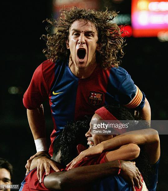Carles Puyol of Barcelona jumps on top of ROnaldinho after Barcelona scored its first goal against Espanyol during a Supercup 2nd leg match at the...