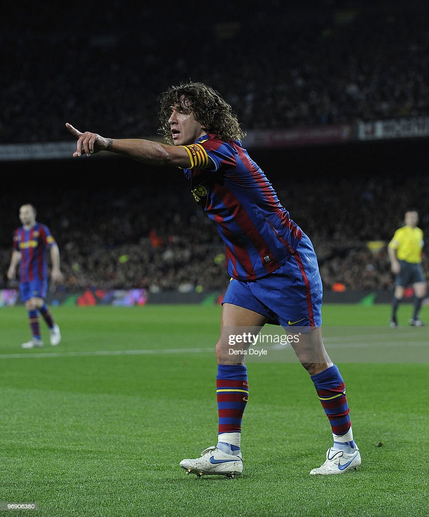 <a gi-track='captionPersonalityLinkClicked' href=/galleries/search?phrase=Carles+Puyol&family=editorial&specificpeople=211383 ng-click='$event.stopPropagation()'>Carles Puyol</a> of Barcelona points for a corner kick to be taken during the La Liga match between Barcelona and Racing Santander at Camp Nou stadium on February 20, 2010 in Barcelona, Spain.