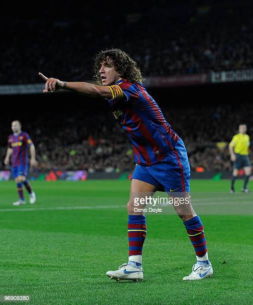 Carles Puyol of Barcelona points for a corner kick to be taken during the La Liga match between Barcelona and Racing Santander at Camp Nou stadium on...