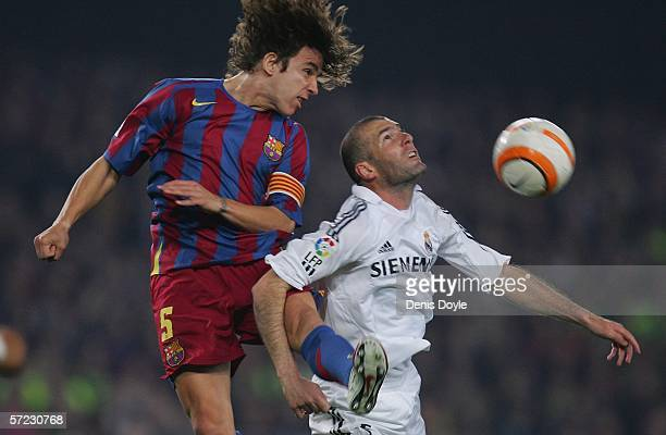 Carles Puyol of Barcelona tackles Zinedine Zidane of Real Madrid during a Primera Liga match between Barcelona and Real Madrid at the Camp Nou...
