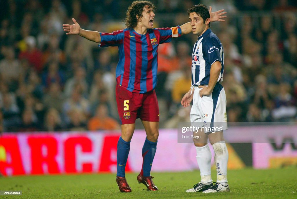 Carles Puyol of FC Barcelona and Nihat of Real Sociedad in action during the La Liga match between FC Barcelona and Real Sociedad, on October 30, 2005 at the Camp Nou stadium in Barcelona, Spain.