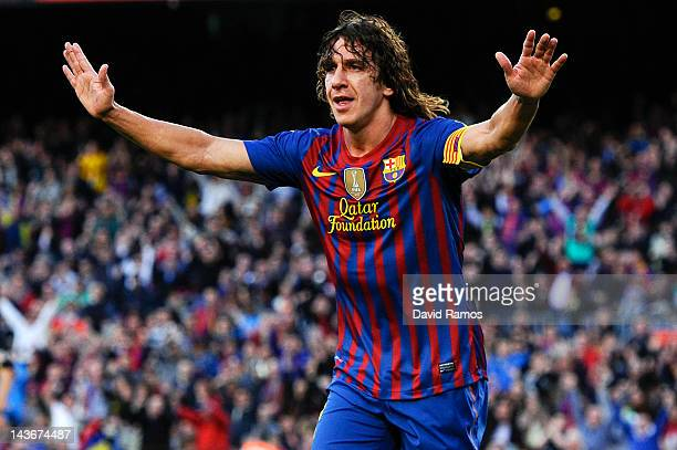 Carles Puyol of FC Barcelona celebrates after scoring the opening goal during the La Liga match between FC Barcelona and Malaga CF at Camp Nou...