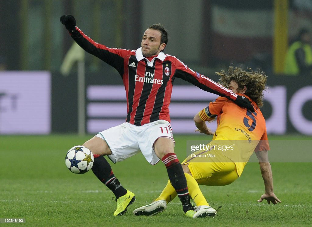 Carles Puyol of FC Barcelona #5 compete for the ball with Giampaolo Pazzini of AC Milan during the UEFA Champions League Round of 16 first leg match between AC Milan and Barcelona at San Siro Stadium on February 20, 2013 in Milan, Italy.