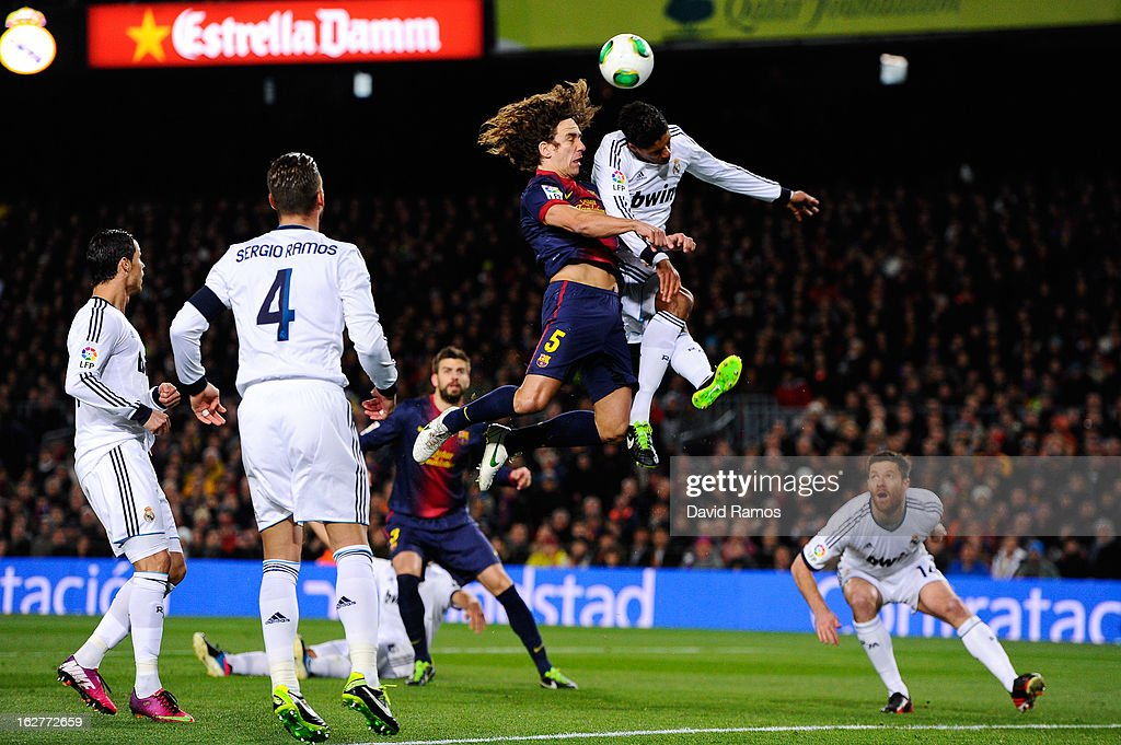 <a gi-track='captionPersonalityLinkClicked' href=/galleries/search?phrase=Carles+Puyol&family=editorial&specificpeople=211383 ng-click='$event.stopPropagation()'>Carles Puyol</a> of FC Barcelona jumps for the ball with Ricardo Varene of Real Madrid CF during the Copa del Rey Semi Final second leg between FC Barcelona and Real Madrid at Camp Nou on February 26, 2013 in Barcelona, Spain.