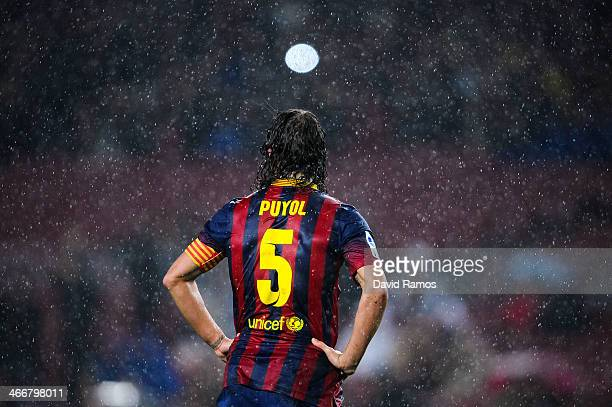 Carles Puyol of FC Barcelona looks on runs with the ball during the Copa del Rey Quarter Final 2nd leg match between FC Barcelona and Levante UD Camp...