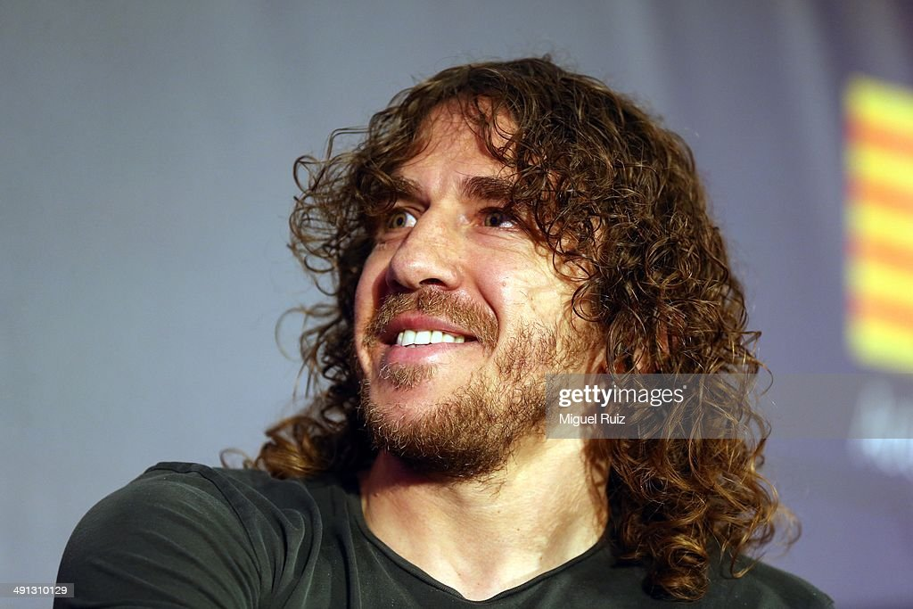 <a gi-track='captionPersonalityLinkClicked' href=/galleries/search?phrase=Carles+Puyol&family=editorial&specificpeople=211383 ng-click='$event.stopPropagation()'>Carles Puyol</a> of FC Barcelona smiles during the farewell press conference as Puyol leaves FC Barcelona at the Auditorium 1899 on May 15, 2014 in Barcelona, Spain.