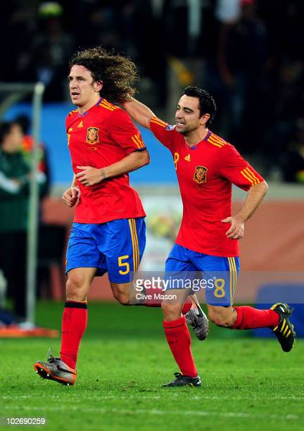 Carles Puyol of Spain celebrates scoring his side's first goal with team mate Xavi Hernandez during the 2010 FIFA World Cup South Africa Semi Final...