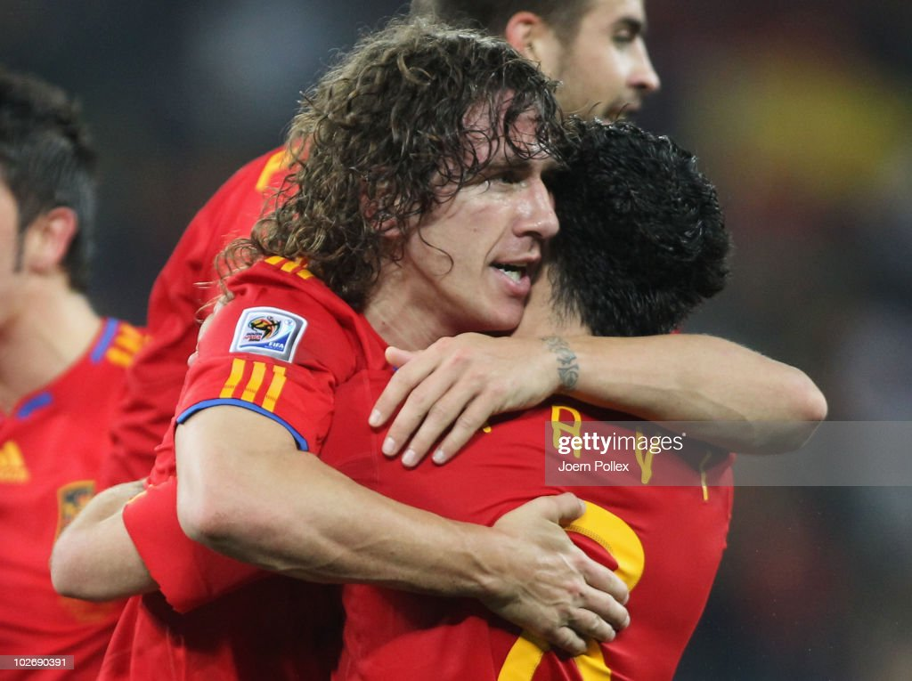 <a gi-track='captionPersonalityLinkClicked' href=/galleries/search?phrase=Carles+Puyol&family=editorial&specificpeople=211383 ng-click='$event.stopPropagation()'>Carles Puyol</a> of Spain celebrates scoring the opening goal with team mate Xavi Hernandez during the 2010 FIFA World Cup South Africa Semi Final match between Germany and Spain at Durban Stadium on July 7, 2010 in Durban, South Africa.