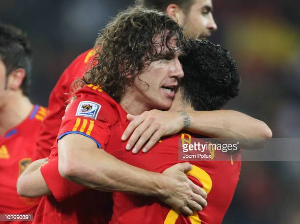 Carles Puyol of Spain celebrates scoring the opening goal with team mate Xavi Hernandez during the 2010 FIFA World Cup South Africa Semi Final match...