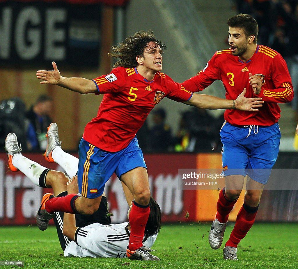 <a gi-track='captionPersonalityLinkClicked' href=/galleries/search?phrase=Carles+Puyol&family=editorial&specificpeople=211383 ng-click='$event.stopPropagation()'>Carles Puyol</a> of Spain (L) celebrates with teammate <a gi-track='captionPersonalityLinkClicked' href=/galleries/search?phrase=Gerard+Pique&family=editorial&specificpeople=227191 ng-click='$event.stopPropagation()'>Gerard Pique</a> after scoring the opening goal during the 2010 FIFA World Cup South Africa Semi Final match between Germany and Spain at Durban Stadium on July 7, 2010 in Durban, South Africa.