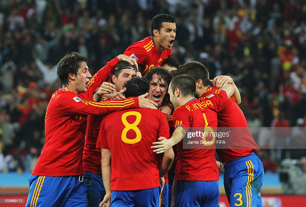 Carles Puyol of Spain celebrates with teammates after scoring the opening goal during the 2010 FIFA World Cup South Africa Semi Final match between...