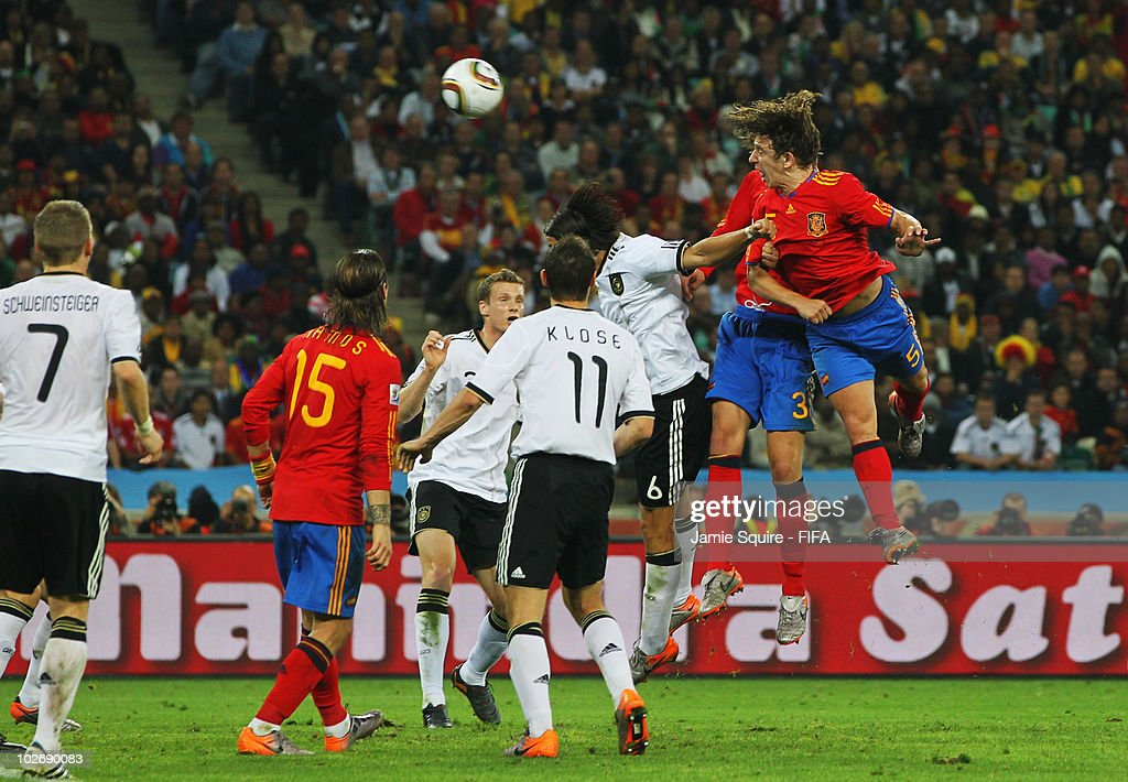 Carles Puyol of Spain heads the ball to score the opening goal during the 2010 FIFA World Cup South Africa Semi Final match between Germany and Spain...