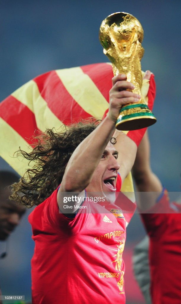 <a gi-track='captionPersonalityLinkClicked' href=/galleries/search?phrase=Carles+Puyol&family=editorial&specificpeople=211383 ng-click='$event.stopPropagation()'>Carles Puyol</a> of Spain lifts the World Cup trophy as the Spain team celebrate victory following the 2010 FIFA World Cup South Africa Final match between Netherlands and Spain at Soccer City Stadium on July 11, 2010 in Johannesburg, South Africa.