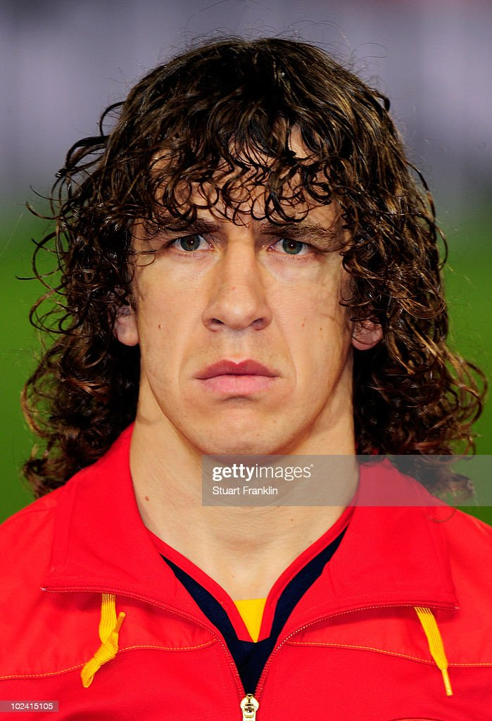 <a gi-track='captionPersonalityLinkClicked' href=/galleries/search?phrase=Carles+Puyol&family=editorial&specificpeople=211383 ng-click='$event.stopPropagation()'>Carles Puyol</a> of Spain lines up for the national anthems prior to the 2010 FIFA World Cup South Africa Group H match between Chile and Spain at Loftus Versfeld Stadium on June 25, 2010 in Tshwane/Pretoria, South Africa.