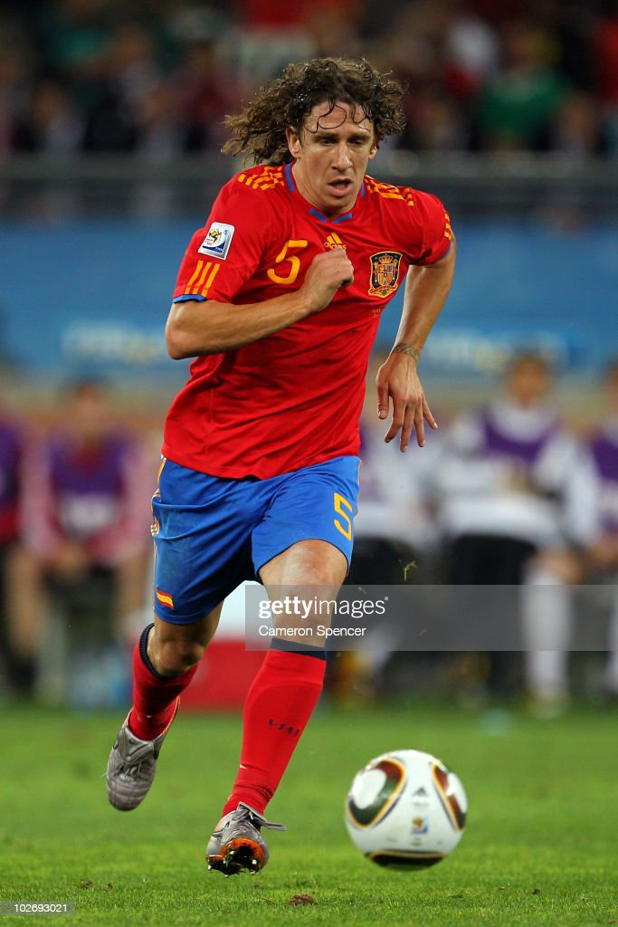 <a gi-track='captionPersonalityLinkClicked' href=/galleries/search?phrase=Carles+Puyol&family=editorial&specificpeople=211383 ng-click='$event.stopPropagation()'>Carles Puyol</a> of Spain runs with the ball during the 2010 FIFA World Cup South Africa Semi Final match between Germany and Spain at Durban Stadium on July 7, 2010 in Durban, South Africa.