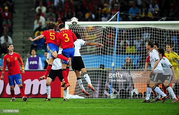 Carles Puyol of Spain scores his side's first goal from a header from a corner kick during the 2010 FIFA World Cup South Africa Semi Final match...