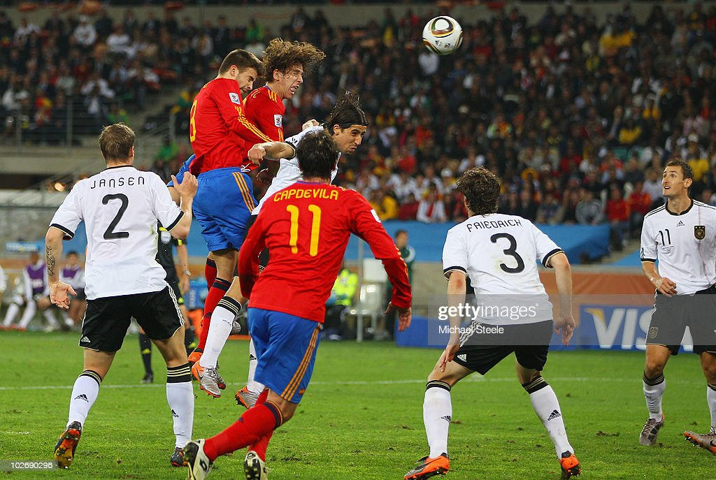 <a gi-track='captionPersonalityLinkClicked' href=/galleries/search?phrase=Carles+Puyol&family=editorial&specificpeople=211383 ng-click='$event.stopPropagation()'>Carles Puyol</a> of Spain scores the opening goal during the 2010 FIFA World Cup South Africa Semi Final match between Germany and Spain at Durban Stadium on July 7, 2010 in Durban, South Africa.