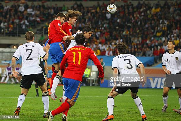 Carles Puyol of Spain scores the opening goal during the 2010 FIFA World Cup South Africa Semi Final match between Germany and Spain at Durban...
