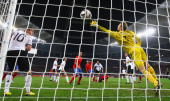 Carles Puyol of Spain scores the opening goal past Manuel Neuer of Germany during the 2010 FIFA World Cup South Africa Semi Final match between...
