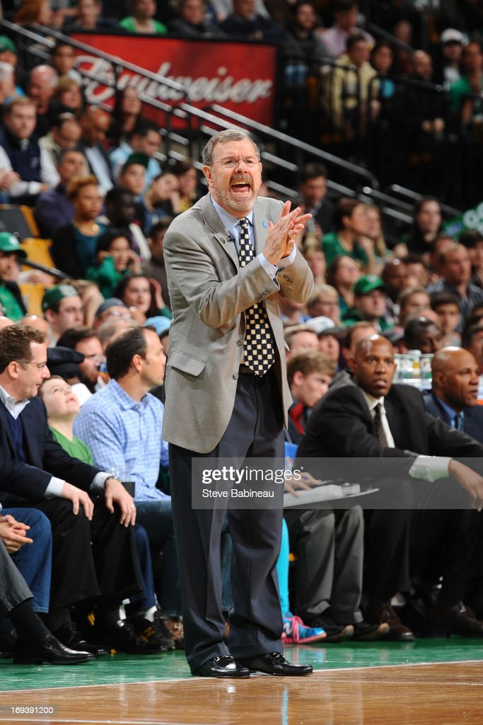 P. J. Carlesimo, Head Coach of the Brooklyn Nets applauds his team during the game against the Boston Celtics on April 10, 2013 at the TD Garden in Boston, Massachusetts.