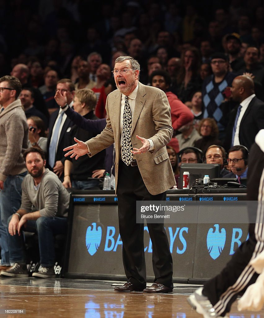 P.J. Carlesimo of the Brooklyn Nets argues a call during the game against the Milwaukee Bucks at the Barclays Center on February 19, 2013 in New York City.