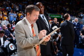 J Carlesimo of the Brooklyn Nets draws up plays from the bench before the game against the Denver Nuggets on March 29 2013 at the Pepsi Center in...