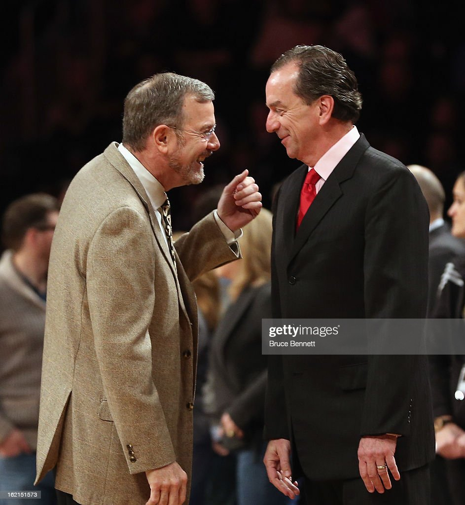P.J. Carlesimo of the Brooklyn Nets speaks with Jim Boylan of the Milwaukee Bucks prior to their game at the Barclays Center on February 19, 2013 in New York City.